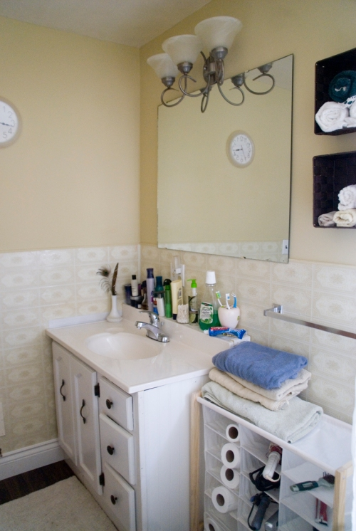 We used left over bead board to build a shelf on top of the vanity because it was a little shorter then the original. Another great storage idea!
